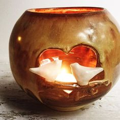 This Love Birds luminary has the magic fire of romance. There will be 1 in both rust and blue in tonight's restock. by leewolfepottery