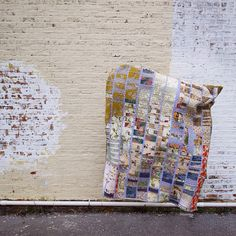 """Artist Heidi Parkes jumping with her quilt, """"The Have Company Quilt,"""" in Chicago. This quilt was made during her artist's residency at Have Company in Grand Rapids, MI. #quilt #quiltart"""