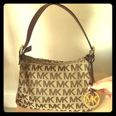 """Authentic Michael Kors tan classic pattern handbag Good used condition, minimal wear on buckles (shown in picture).  Dimensions: 11.5"""" x 8"""", strap is 7.5 inches MICHAEL Michael Kors Bags Shoulder Bags"""