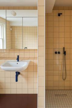 The bathrooms feature pink tiles, vinyl floors and coloured taps. Interior Garden, Bathroom Interior, Sunken Patio, Red Brick Walls, Pink Tiles, Victorian Buildings, Exterior Cladding, Room Tiles, Victorian Design