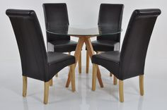 ATLANTICO CIRCLE GLASS DINING TABLE SET WITH 4 BROWN CHELSEA CHAIRS The Circle Atlantico table offers a simple yet supremely elegant design that is right on trend. Ideal for use in any contemporary kitchen, this table is functional and tastefully understa