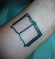 Book tattoo. but I would love to have my favorite book titles in it, in their specific font