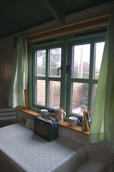 A homely Plankbridge shepherd's hut interior