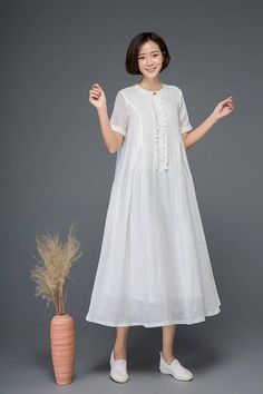 The white linen dress is made of linen blend. The day dress has a linen lining. The long dress is very loose and comfortable. The womens dress has a button and trims on the front. The cute dress has two side pockets. Long Summer Dresses, Women's Dresses, Cute Dresses, Fashion Dresses, Dresses For Work, Dress Summer, Dress Long, Awesome Dresses, Floral Dresses