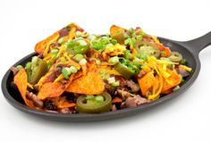 DORITOS® Nacho Cheese BBQ Brisket Nachos   Don't know what to do with the leftovers from yesterday's BBQ? Look no further than this nachos recipe perfect for your next tailgate!