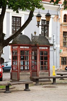 Telephone booth on Vilniaus Street in Kaunas, Lithuania Kaunas Lithuania, Telephone Booth, Rooftops, Baltic Sea, Gazebo, Europe, Outdoor Structures, Street, Building
