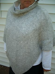 Feather-weight poncho in stockinette stitch featuring a garter band across the bottom edge. This simple poncho is made from a rectangle folded in half and seamed. A loose turtleneck is created by picking up and knitting around the neck opening. This lightweight and cozy wrap can be styled any number of ways by spinning it around the body.
