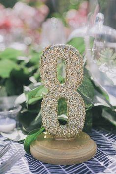 glitter table number, photo by Edyta Szyszlo http://ruffledblog.com/allied-arts-guild-wedding #weddingideas #tablenumbers