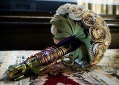 wire to hold the bouquet together. i love the bronze and gold! book-page flowers AND steampunk handle whaaaaa/........?