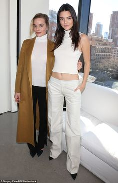 Towering: Despite wearing black pointed-toe heels, Margot, who stands at just over 5ft 5ins, managed to only just reach Kendall's eye line