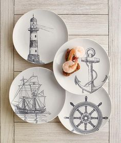 Marine Dessert Plates | Serve up a helping of deep-sea style with these dessert plates that feature a lighthouse, anchor, ship's wheel, and frigate. Set of four.
