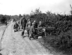 French; 1st Regiment de Marche de la Legion Etrangere(RMLE). A Hotchkiss machine gun crew under training at the Camp at Dampierre in July 1917