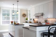 Coastal kitchen chic with marble + shaker style cabinets via Kate Jackson Design