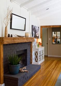 15 Painted Brick Fireplaces That Radiate Coziness : Bold, black paint can turn even the most basic builder-grade closet doors into architectural statements. See how to make a black door work in your own interior space. Black Brick Fireplace, Painted Brick Fireplaces, Paint Fireplace, Brick Fireplace Makeover, Home Fireplace, Fireplace Design, Fireplace Ideas, Fireplace Doors, Brick Fireplace Remodel