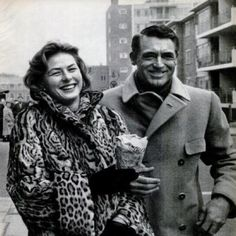 Pals Ingrid Bergman and Cary Grant share some street side pommes frites.