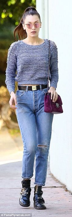 Quick change: Bella later emerged wearing the exact same outfit, save for a new grey sweat...