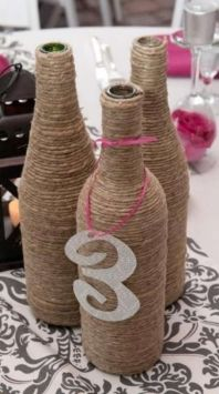 Wrap bottles with twine or ribbon - This and mason jars or lanterns