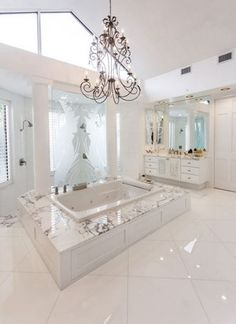 This breathtaking white bathroom was completed by Nature Of Marble.