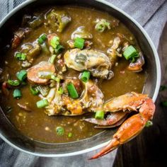 This Louisiana Seafood Gumbo with Okra is packed full of seafood including shrimp crawfish oysters crab and andouille sausage - plus it only takes 40 minutes to make! new orleans style gumbo How To Make Gumbo, New Orleans Gumbo, Louisiana Seafood, Seafood Recipes, Gumbo Recipes, Sausage Gumbo, Seafood Gumbo, One Pot Meals, Quick Meals