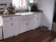white bead board back splash. white kitchen.