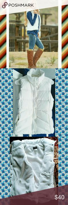 EUC  J. Crew Winter White Down Vest Classic winter white quilted down, fleece lined down vest,..front zips from top and bottom... feminine details abound... front placket features low profile logo embossed snaps, and princess seaming, on seam front slash pockets, inner adjustable stretch draw cords and curved rear hemline all add up to figure flattering, flirty awesomeness!!!! J. Crew Jackets & Coats Vests