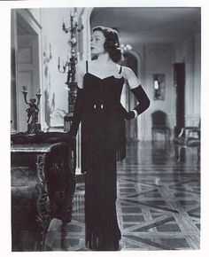 Gene Tierney in The Razor's Edge, 1946, gorgeous fringed black dress by Oleg Cassini.