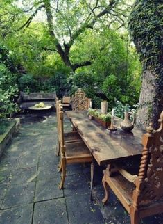 Serene courtyard with long table, surrounded by big trees