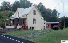 Charming 1900's Farmhouse with ... multiple outbuildings all on 5 acres very close to Sevierville. Many updates have been done including new subflooring and beautiful walnut flooring throughout, all walls have been refinished and have a fresh coat of neutral paint. New plumbing and electric, Central air and heat replaced in 2011.