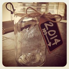 Mason jar centerpiece for graduation party w chalkboard label