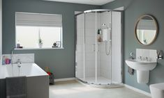This gorgeous modern interior features a stylish electric shower, corner shower enclosure, a wall hung basin and a bath with grey bath panels. Corner Shower Enclosures, Grey Baths, Bath Panel, Slide Bar, Shower Kits, Grey Oak, Downstairs Bathroom, Wall Brackets, Grey Bathrooms