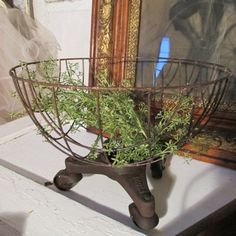 Rusty metal wire basket with industrial wheels by AnitaSperoDesign, $ ...