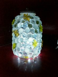 Upcycled apple sauce jar with battery operated LED lights. Made with E-6000 craft glue and floral gems.