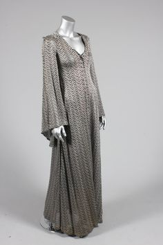 Biba silver and black 'glam rock' knitted lurex evening gown, late woven art nouveau label, front buttoning, long, flared sleeves Biba Fashion, Retro Fashion, Vintage Fashion, Vintage Gowns, Vintage Outfits, Vintage Barbie, Biba Clothing, Vintage Clothing, Evening Gowns With Sleeves