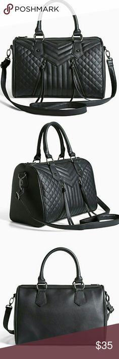 """Torrid quilted black satchel purse DETAILS We're on a major quilt trip...can you blame us? This black faux leather satchel bag has wear-everyday quality with just the right amount of edge thanks to the quilted front and double hematite zippers. A removable strap lends versatility. 56"""" strapMan-made materialsImported torrid Bags Satchels"""