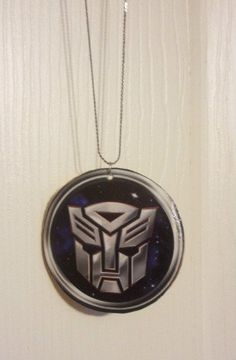 My Necklace for the Wedding - Base from Meijer. Transformers image from coloring book. Made with Mod Podge.