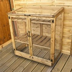 diy small greenhouse | Waltons Mini Wooden Greenhouse… Looks small enough to fit on a balcony to start veggies early...