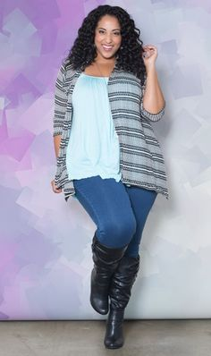I'm seeing this style a lot and I love it! Loose long top with cardigan over skinny jeans and boots.