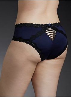 "<div>A flirty, feminine panty with a bit of cheeky attitude. Silky navy microfiber is a little coquettish, while black lace trim and a lace up back are so sexy. In our new cheekster cut (rise of our hipster, with the exposure of our cheeky).</div><div><ul><li style=""LIST-STYLE-POSITION: outside !important; LIST-STYLE-TYPE: disc !important"">Medium coverage</li><li style=""LIST-STYLE-POSITION: outside !important; LIST-STYLE-TYPE: disc !important"">Polyester/spandex; lining: cotton</li><li…"