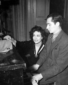 Composer Paul Mertz plays for Joan Crawford on the set of They All Kissed the Bride