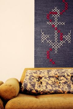 giant cross-stitch and vintage upholstery. love.