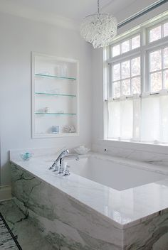 small chandelier over tub