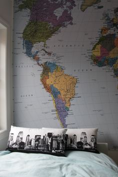 The map wall is such a unique idea, but I am in love with the graphic pillows!!