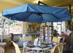 11ft. Cantilever Umbrella with 360 degree rotation, 2 year warranty and 4 year fabric warranty. Check out www.belltoweroutdoorliving.com for more information or call 855-866-7163 or email belltower@btolc.com.