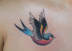 Colored Swallow Tattoo On Chest