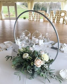 silver hoop with floral base and hanging glass baubles Wedding Table Centres, Wedding Flower Arrangements, Wedding Table Centerpieces, Diy Wedding Decorations, Reception Decorations, Event Decor, Floral Arrangements, Wedding Flowers, Christmas Decorations
