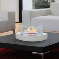 Forget about candles and other tabletop accents to add ambiance. The Lexington fireplace brings you all the tabletop elegance you are looking for with its distinctive shape, high gloss white finish an
