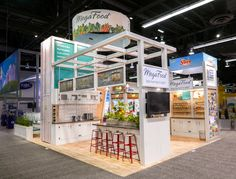 Mega Food's tradeshow booth design incorporates many live plants and various natural textures