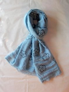 Elena Milani Couture- Daisy handmade silkscreen light blue cotton scarf. Soft and charmy scarf, 100% made in Italy, made in Venice. The scarf is 100% cotton muslin and it has a handmade decor, made with an artisanal silkscreen. This scarf can double up around the neck for a super cozy look. Caring for this scarf is super easy! Machine wash cold water with any non-bleach detergent. Hang dry and press on a low heat setting. The hand dyed process is an artfully crafted skill, making each…