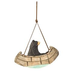Wood Canoe Bear. NATURAL MATERIAL ORNAMENTS: These camping Christmas tree ornaments are made from natural materials like metal and wood which sets the tone of an outdoor nature-type style with your decorations. They are also relatively sturdy for packing and travel.