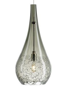 Off Seguro Satin Nickel One Light Mini Pendant by LBL Lighting. @ Transparent glass with a crackle texture. Includes 6 Foot of field cuttable suspension cable. @ Bulb is Included